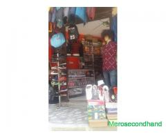 Man wear fancy shop for sell at Dallu